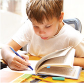 child_writing_in_book